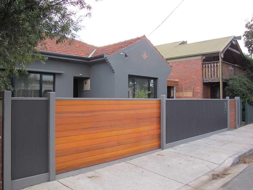 Cedar Sliding gate with Ripple Iron Fencing